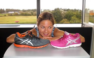 A woman looking at 2 different coloured Asics Gel-Zaraca 3 shoes